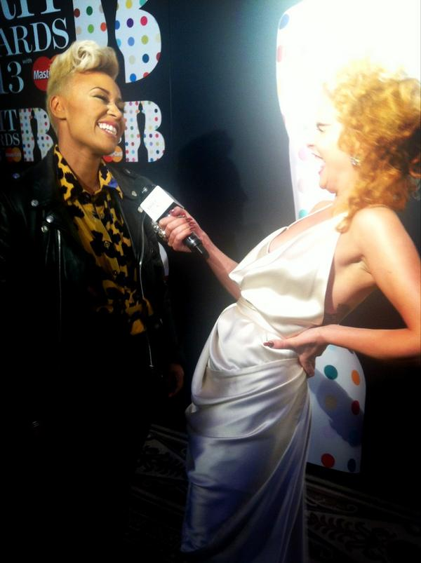 Brit Award Nominee Emeli Sande Shares A Laugh With Paloma Faith On The Red Carpet